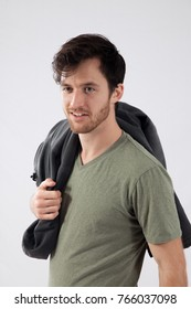 Happy man with a jacket over his shoulder