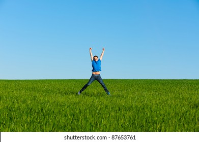 happy man jumping on the green field