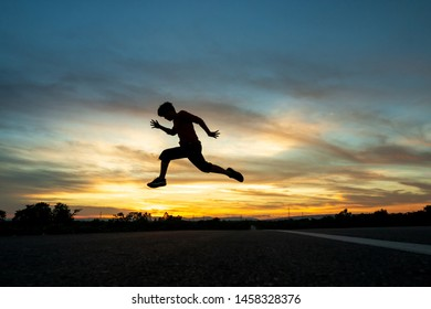 Happy man jumping At the time of the sun set Concept of vacation and travel