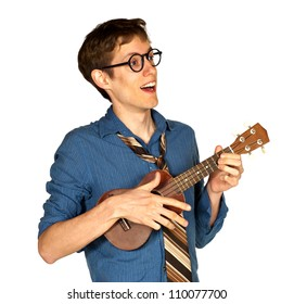 Happy man looking off to the side while playing a ukelele and singing, isolated on white background.