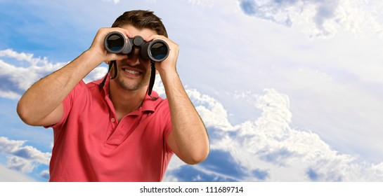 Happy Man Looking Through Binocular, Outdoors