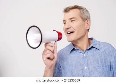 Happy man making announcement over a bullhorn