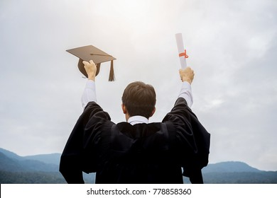 happy man on her graduation day University. student in graduation cap with certificate. Education and people.