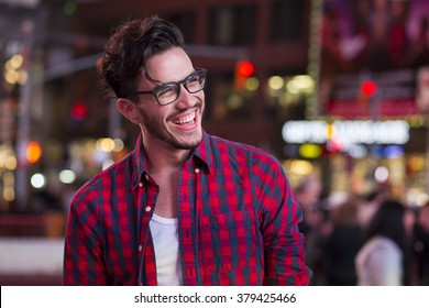 Happy man on Times Square, New York, at night