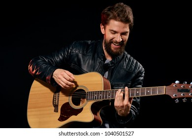 happy man playing the guitar