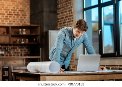 Happy man reading email from boss