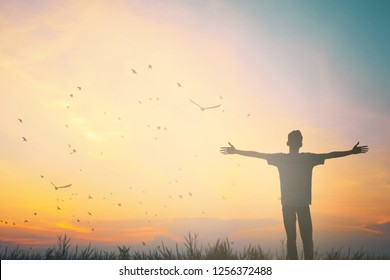 Happy man rise hand on morning view. Christian inspire praise God on good friday background. Now one man self confidence on peak open arms enjoying nature the sun concept world wisdom fun hope