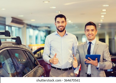 happy man showing thumbs up in auto show or salon