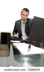 happy man sitting on sofa with laptop