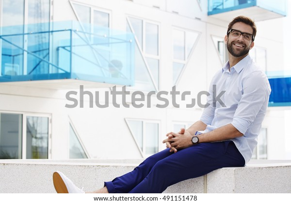 Happy man smiling in blue fashion
