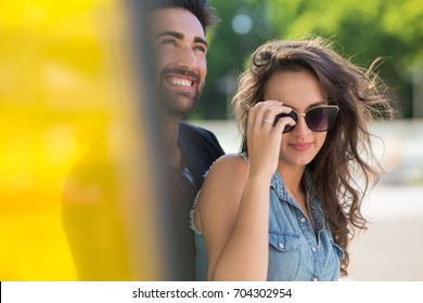 Happy man smiling with girlfriend in sunglasses