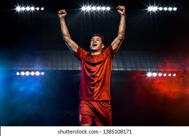 Happy man - soccer player. Boy in football sportswear after goal celebrating. Sport concept.