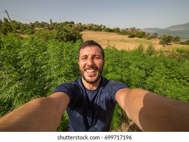 happy man take selfie photo with Marijuana. landscape photo asia, background mountain Marijuana bloom Plants nature of farm field with green, Planted legal ,Thickets cannabis plants weed marihuana.