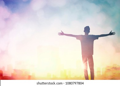 Happy man though rise hand on city morning view. Christian inspire praise God on good friday background. One man self confidence on peak open arms enjoying nature the sun concept world wisdom fun hope