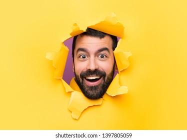Happy Man through a hole paper