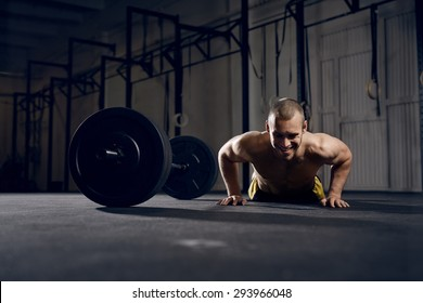 Happy man training burpees at gym