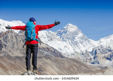 Happy man Traveler with Backpack hiking in Himalayas with Everest mountain background. mountaineering sport lifestyle concept