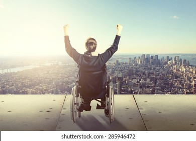 Happy man in wheelchair in front of city skyline