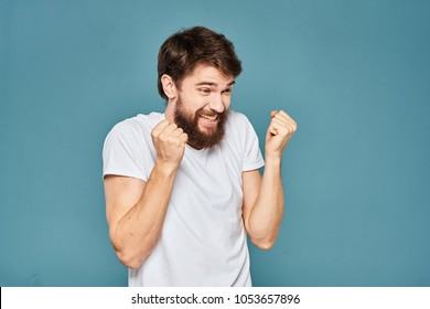 happy man is happy in a white T-shirt