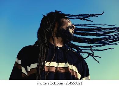 "Happy man with ""windy"" dreadlocks. Caribbeans."