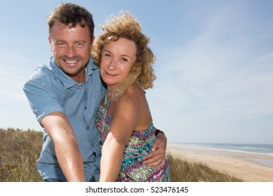 Happy man and woman couple smiling and happy in sunshine