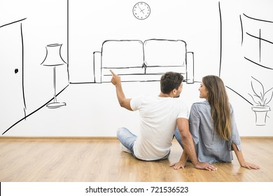 The happy man and woman dream near virtual room on the wall