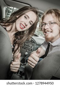 Happy man and woman during traveling trip. Couple, friends sitting inside vehicle car driving riding somewhere.