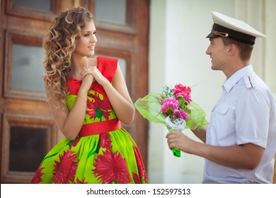 Happy man and woman on dating, loving couple embracing. Teenage couple embracing on dating.  Beautiful Young Couple man and woman in love. happy loving couple. Young couple in love outdoor.