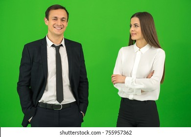 The happy man and woman stand on the green background