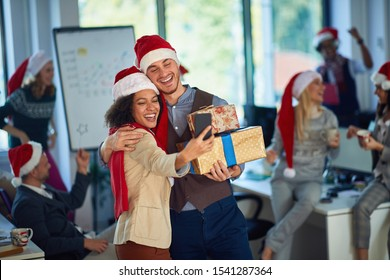 Happy man and woman  take selfie photo shot  celebration on christmas  at the office.