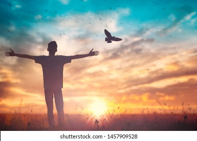 Happy man worship for peace on morning view. Christian inspire praise God on good friday background. Self confidence empowerment on  courage love concept strength wellbeing wisdom financial