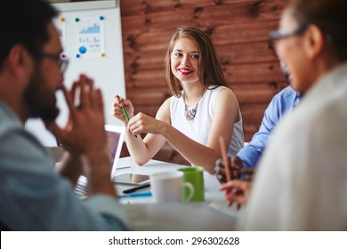 Happy manager looking at colleague during conversation