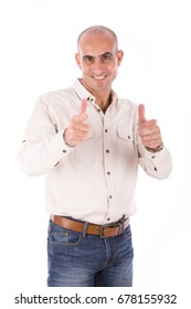 Happy mature bald man pointing to something, guy wearing beige shirt and jeans, isolated on white background