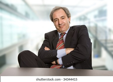 happy mature business man working on a desk