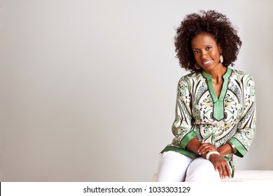 Happy mature confident African American woman smiling.
