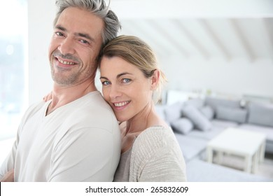 Happy mature couple in brand new home