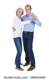 Happy Mature Couple Dancing Isolated Over White Background