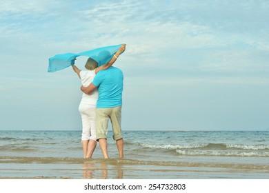 Happy Mature couple enjoy fresh air on beach