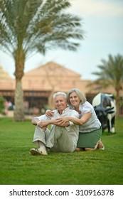 Happy Mature couple enjoy fresh air on vacation