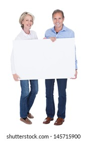 Happy Mature Couple Holding Blank Placard Isolated Over White Background