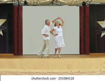 Happy Mature couple in love dancing
