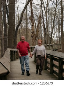 A happy mature couple on a walk.