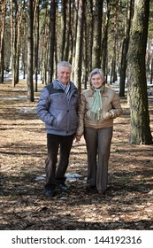 happy Mature couple on a walk in the forest in the spring
