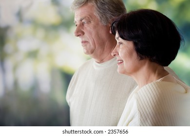 Happy mature couple, outdoor. Focus on woman