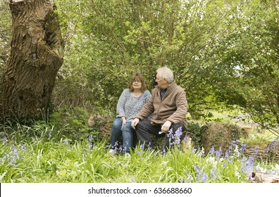 Happy mature couple sitting outdoors
