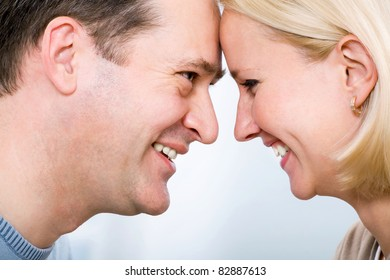 ? happy mature couple together over a background