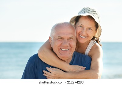 Happy mature couple together at sea beach