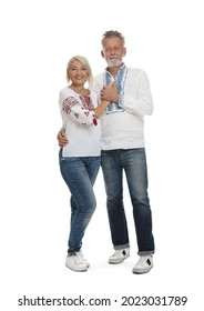 Happy mature couple in Ukrainian national clothes on white background