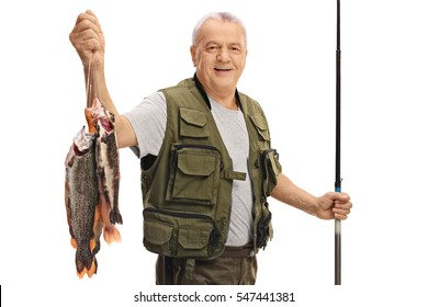 Happy mature fisherman with a fresh catch and a fishing rod isolated on white background