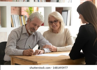 Happy mature husband and wife sign contract closing deal with female bank specialist taking loan together, pensioner clients couple meeting with realtor put signature on agreement buying property